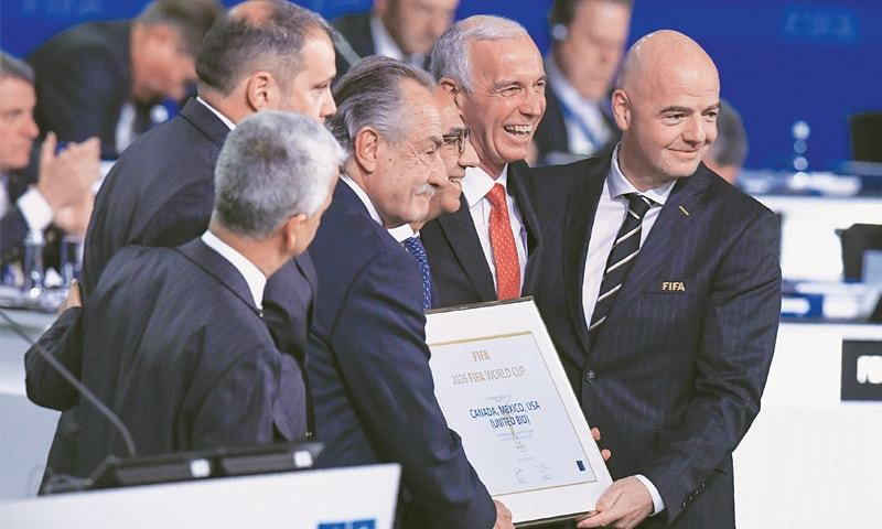 FIFA president Gianni Infantino (R) poses with the United 2026 bid (Canada-Mexico-US) officials Carlos Cordeiro (third R), president of the United States Football Association, president of the Mexican Football Association Decio de Maria Serrano (third L) and Steve Reed (second R), president of the Canadian Soccer Association, following the announcement of the 2026 World Cup host during the 68th FIFA Congress at the Expocentre on Wednesday.—AFP
