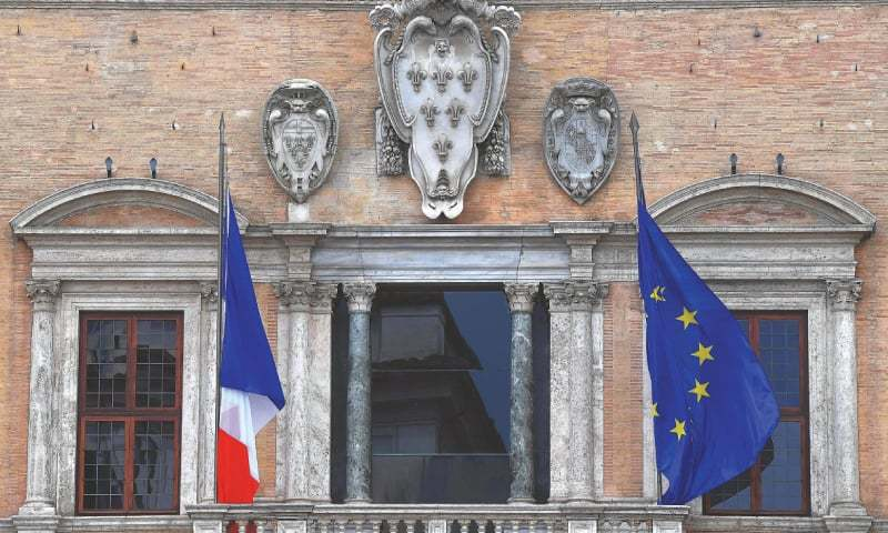 ROME: The French and European Union flags flutter outside the French Embassy on Wednesday. Italian Economy Minister Giovanni Tria cancelled a meeting with his French counterpart in Paris scheduled for Wednesday, amid a diplomatic row over a migrant ship that Italy refused to accept.—AFP