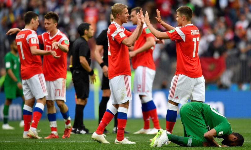 Russian players celebrate after defeating Saudi Arabia at the Luzhniki Stadium in Moscow. —AFP