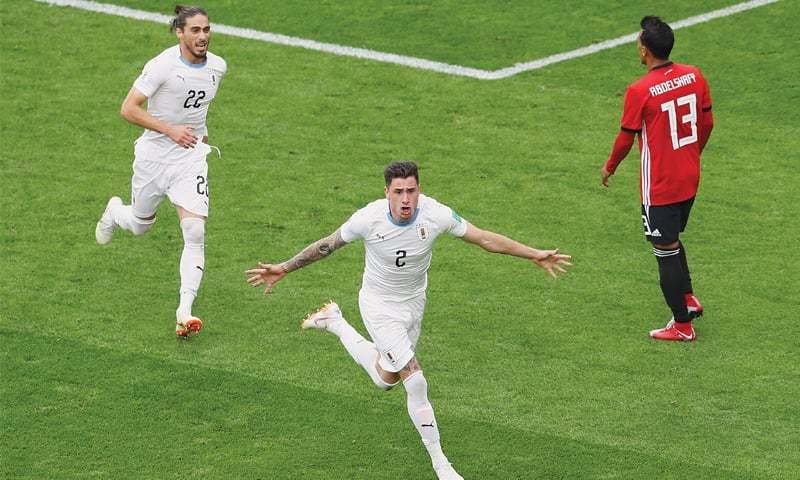 YEKATERINBURG: Jose Gimenez (R) celebrates scoring Uruguay's match-winning goal with Martin Caceres at the Ekaterinburg Arena on Friday.—Reuters