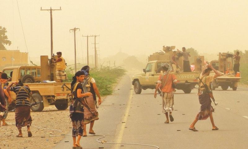 Yemeni pro-government forces gather near Hodeida airport on Friday.—AFP