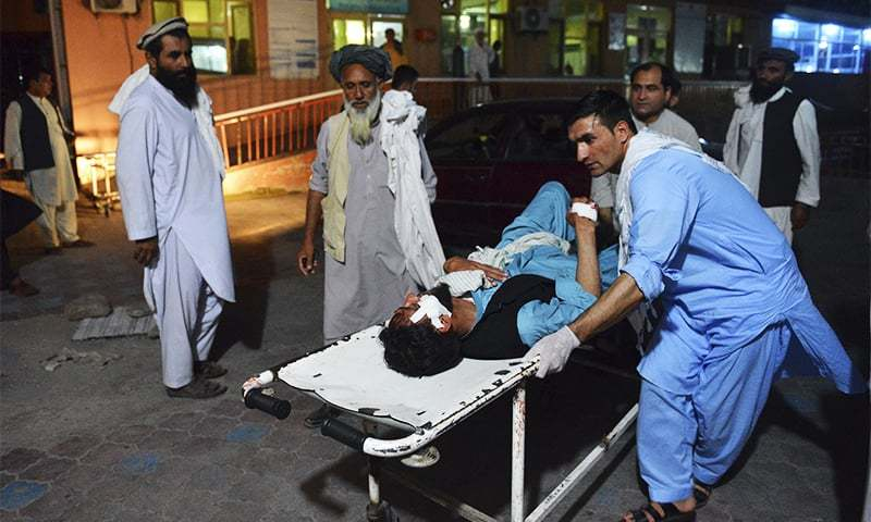 A wounded man is brought by stretcher into a hospital in Jalalabad city, capital of Nangarhar province. ─ AP