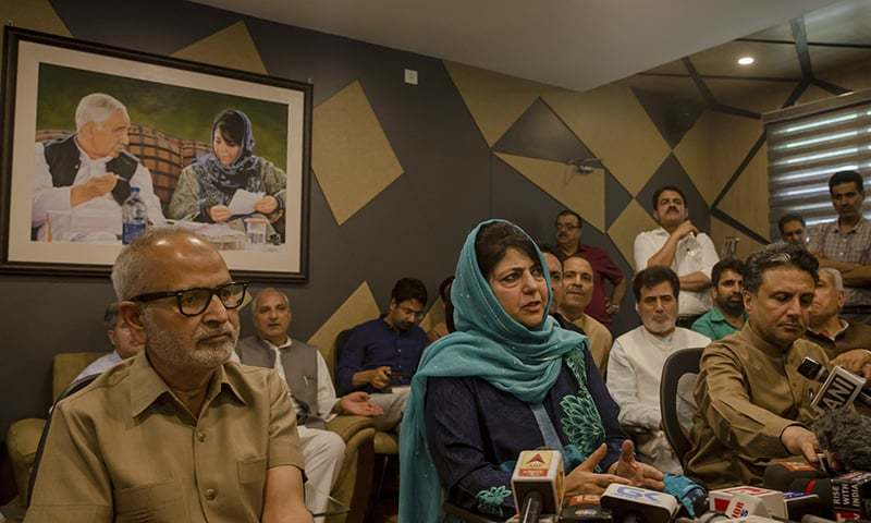 PDP leader Mehbooba Mufti, centre, surrounded by members of her former cabinet addresses the media after resigning as the chief minister of Jammu and Kashmir after BJP pulled out of the coalition. — AP