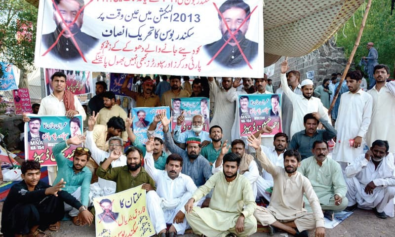 PTI workers protest outside Imran Khan's residence in Banigala on Tuesday. — White Star