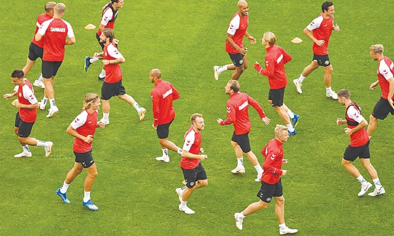 DENMARK players attend a practice session at the Cosmos Arena on Wednesday.—AFP
