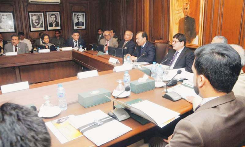 THE caretaker chief minister presides over the cabinet meeting at New Sindh Secretariat on Friday.—PPI