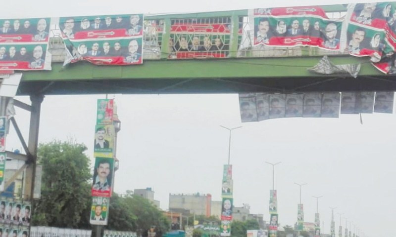 POSTERS of candidates for National Assembly seat NA-70 (Gujrat-III) displayed across the GT Road in Lala Musa.—Photo by writer