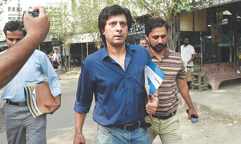 IN this file photo, Jawad Ahmed heading to the sessions court to submit his nomination  papers last month. The singer will be contesting election against Shahbaz Sharif, Imran Khan and Bilawal Bhutto-Zardari. —M. Arif / White Star