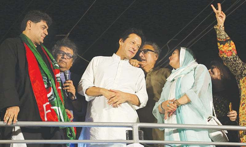 KARACHI: Pakistan Tehreek-i-Insaf chairman Imran Khan and other party leaders, including former MNA Arif Alvi, at a rally in Gulistan-i-Jauhar on Tuesday. Imran Khan is in Karachi for a two-day visit to lead the party's election campaign.—White Star
