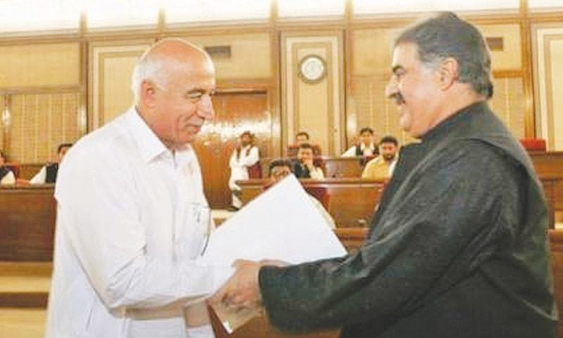In this file photo Dr Abdul Malik Baloch (left) and former chief minister of Balochistan Sanaullah Zehri shake hands after the former resigned as head of the province.