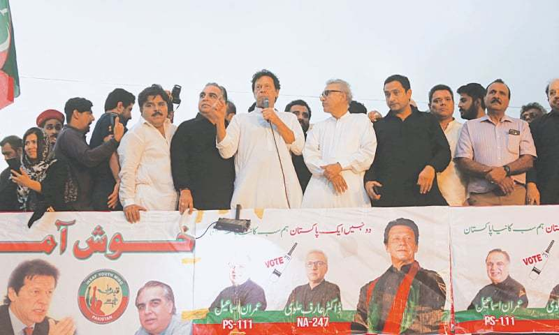 PTI chief Imran Khan addresses a public meeting on Wednesday.—White Star