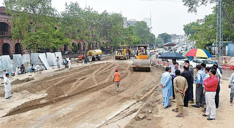 The road at GPO Chowk is being levelled after filling sinkholes which appeared during heavy rain on Tuesday. — White Star