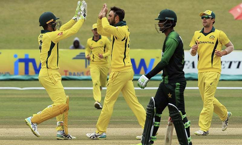 Australian cricket players celebrate taking the wicket of Pakistan batsman Hassain Talat. — AP