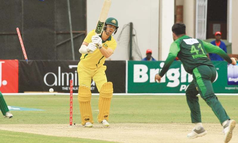 HARARE: Australian batsman Travis Head is cleaned up by Pakistan pacer Faheem Ashraf during the tri-series T20 International at the Harare Sports Club on Thursday.—AP