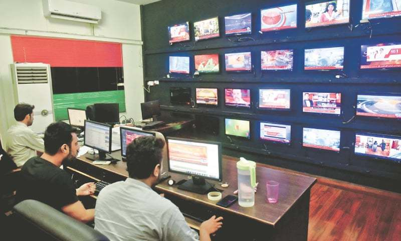 Members of PPP's media monitoring response team working at the cell at Bilawal House in Karachi.