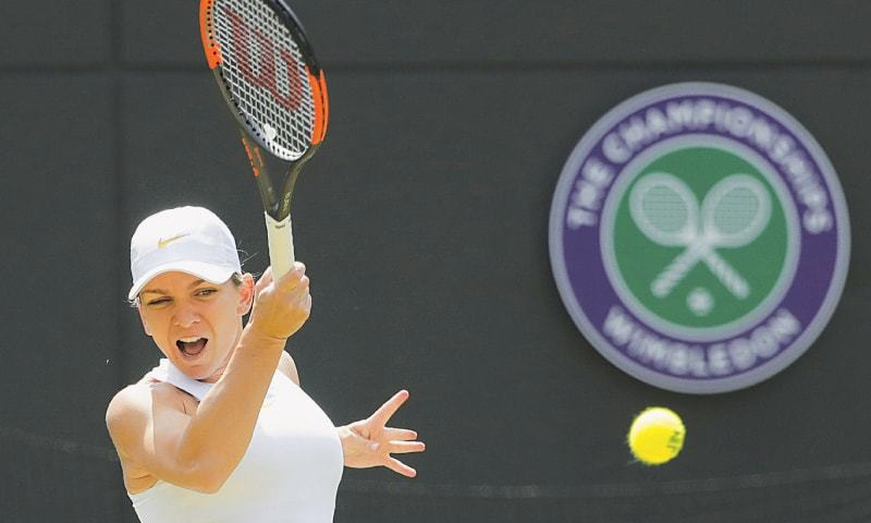 TOP seed SIMONA Halep returns the ball to Su-Wei Hsieh during their third-round match at Wimbledon on Saturday.—AP