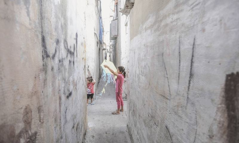 The 10-year-old sister of Mohammad Ayyoub (centre) plays in front of their family house in the Jabalya refugee camp in Gaza  | Wissam Nassar/The Washington Post