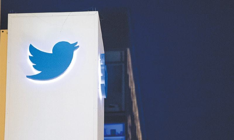 The Twitter logo is seen on a sign at the company's  headquarters in San Francisco, California.—AFP