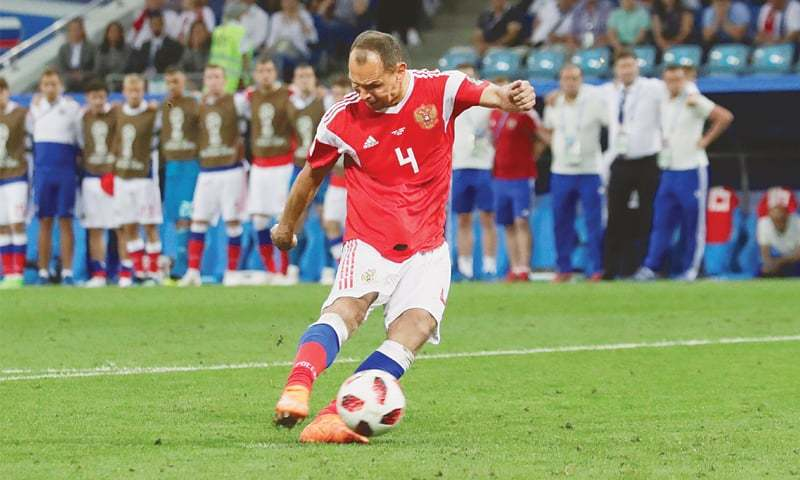 SERGEI Ignashevich's final act for Russia as he scores during the shootout.—Reuters