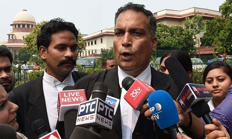 Indian defence lawyer AP Singh representing men accused of gang raping and murdering a woman in 2012 talks to the media outside India's Supreme Court building in New Delhi