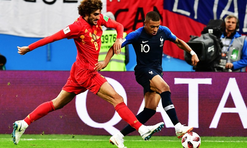 Kylian Mbappe is marked by Marouane Fellaini during the Russia 2018 World Cup semi-final football match between France and Belgium at the Saint Petersburg Stadium. —AFP