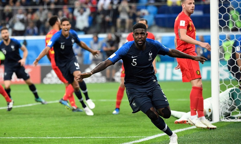 France's defender Samuel Umtiti celebrates scoring the opening goal during the Russia 2018 World Cup semi-final against Belgium. —AFP