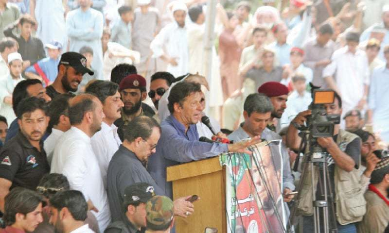 Imran Khan addresses a public meeting in Bisham on Tuesday. — Dawn