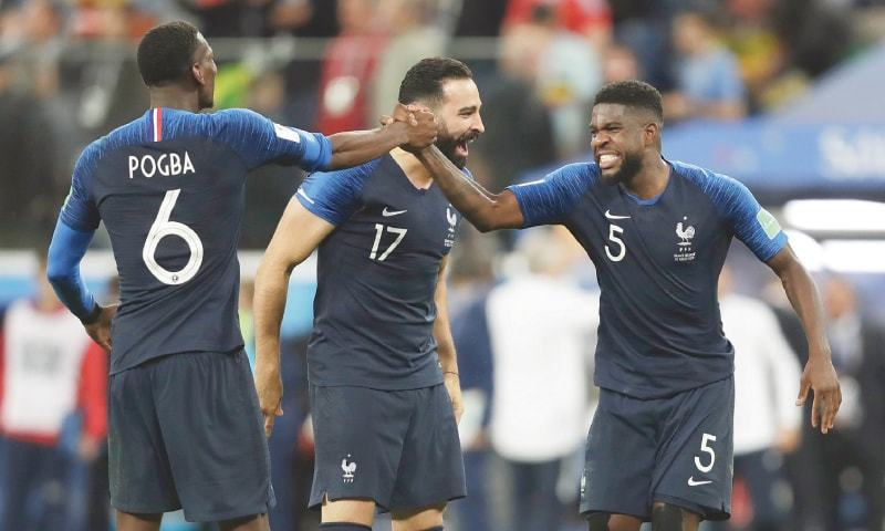 FRANCE's Samuel Umtiti (right) celebrates the win with teammates Adil Rami and Paul Pogba.—AP