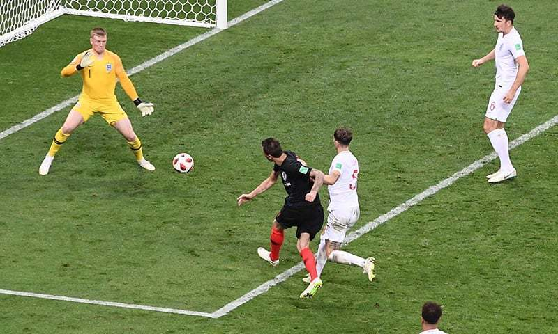 Croatia's forward Mario Mandzukic shoots and scores his team's second goal during the Russia 2018 World Cup semifinal at the Luzhniki Stadium.   —AFP