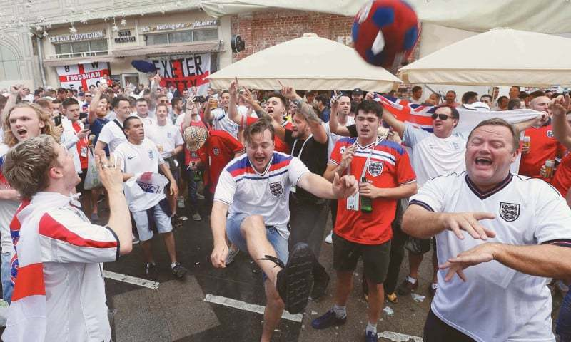 MOSCOW: England fans play with a toy ball during a gathering in the city centre on Wednesday, ahead of the semi-final against Croatia.—Reuters