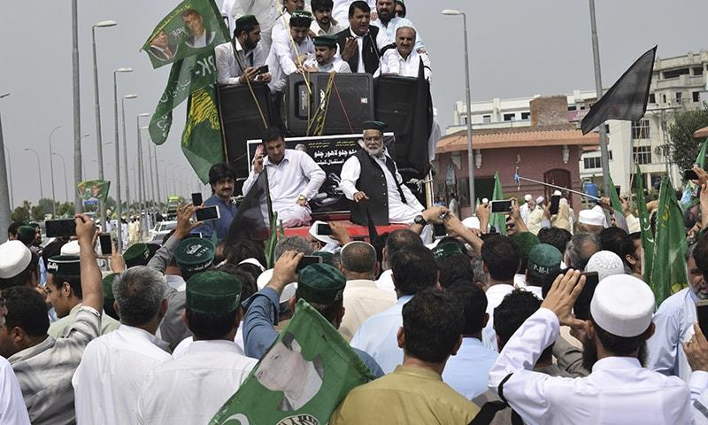 PML-N supporters chant at a rally in Peshawar on Friday. — AP