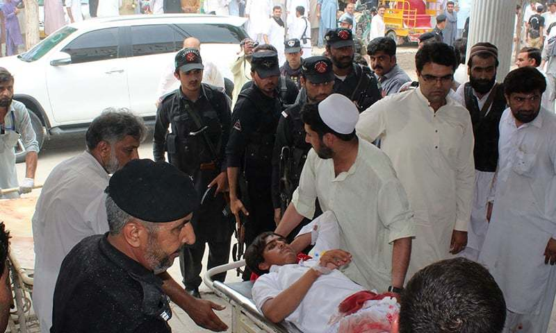 A youth injured in Mastung bomb blast is transported at a hospital in Bannu. — AFP