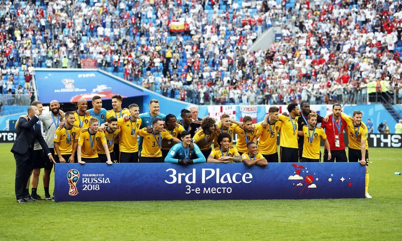 Belgium players and team staff pose for a team picture after defeating England in the third place match at the 2018 soccer World Cup in the St. Petersburg Stadium. —AP