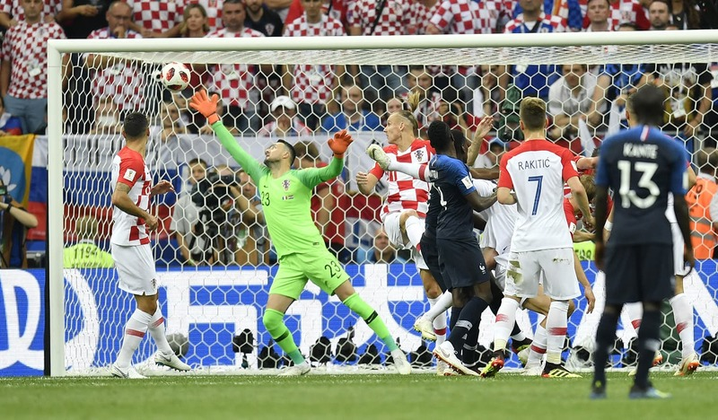 Croatia's Mario Mandzukic scores an own goal past Croatia goalkeeper Danijel Subasic. —AP