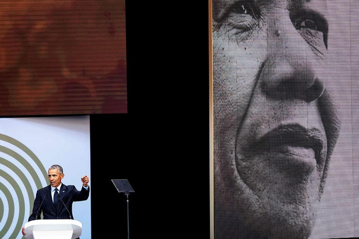 Former US President Barack Obama speaks during the 2018 Nelson Mandela Annual Lecture in Johannesburg. —AFP