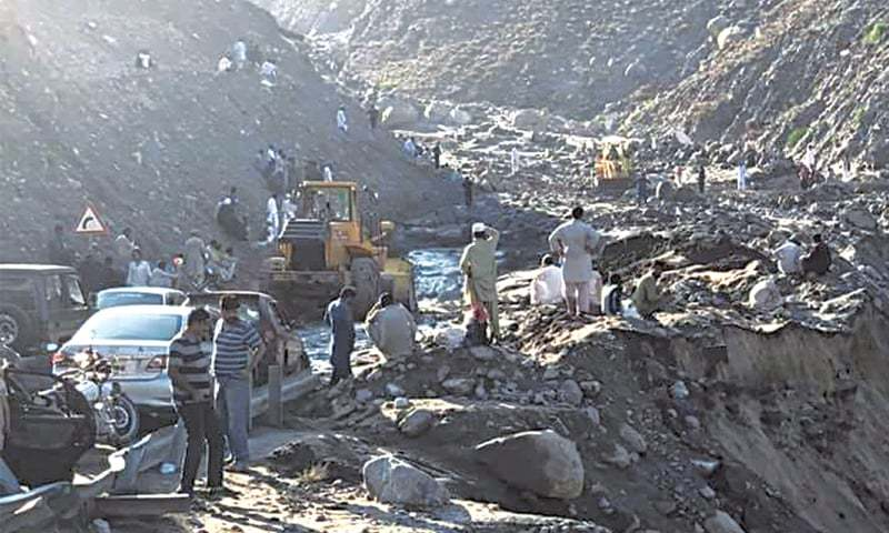 Vehicles are stranded on Thursday in the Gonarforam area of Diamer district as the Karakoram Highway has been blocked.—Dawn