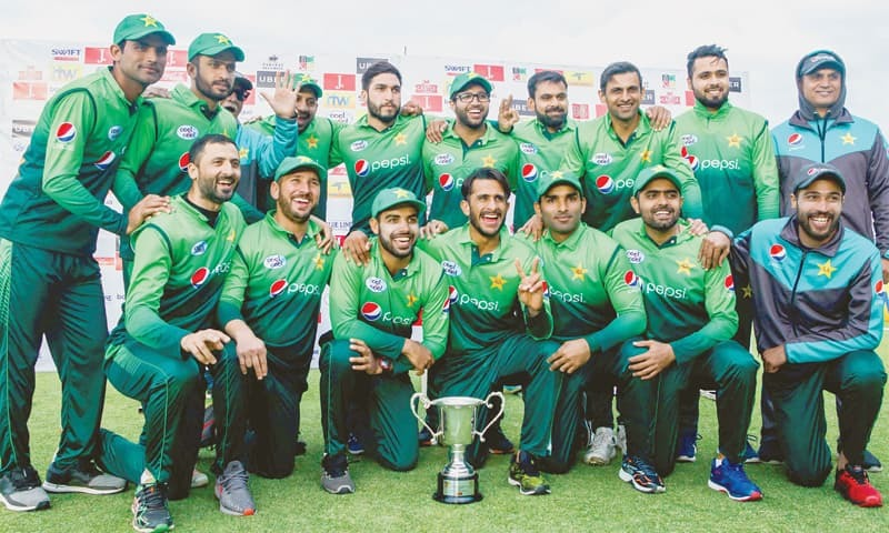 BULAWAYO: The victorious Pakistan team members pose with the trophy after completing a 5-0 sweep of the ODI series against Zimbabwe at the Queens Sports Club on Sunday.—AFP