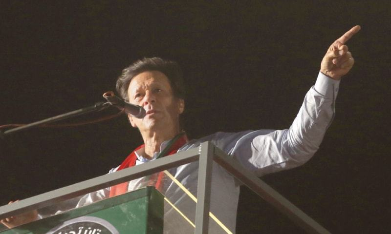 PTI chief Imran Khan addressing the rally outside the Quaid's Mazar.—White Star