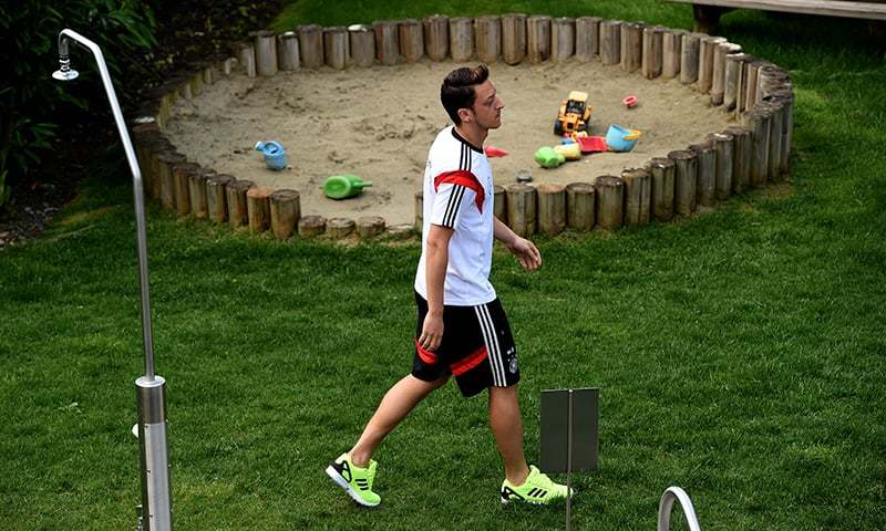 In this file photo Mesut Oezil walks past a sandbox as he attends a media day of the German national football team at the San Andreus hotel in San Martino in Passiria, Italy. — AFP