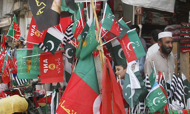 Flags of political parties on sale ahead of elections. —AP
