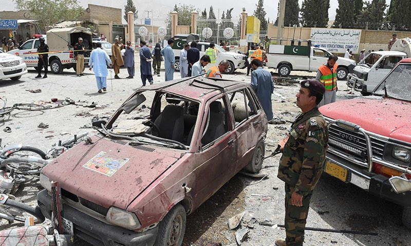 Security personnel gather at the site of the suicide attack near a polling station in Quetta on July 25. — AFP