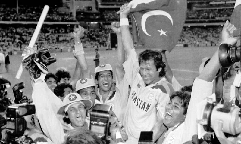 Imran Khan, waving a Pakistan flag, is cheered by his teammates after Pakistan defeated England in the 1992 World Cup Cricket final, in Melbourne, Australia. —AP/File
