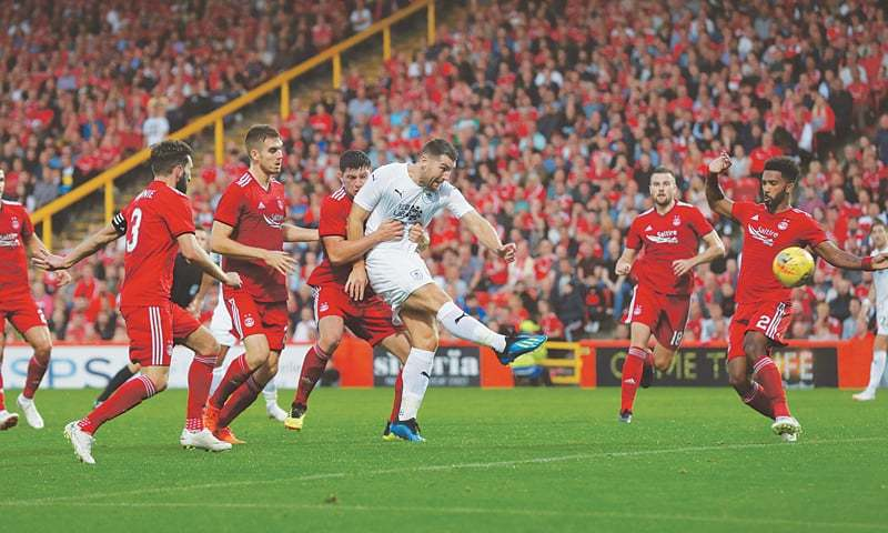 ABERDEEN: Burnley's Sam Vokes shoots to score during the first leg of their Europa League second qualifying round tie against Aberdeen at the Pittodrie Stadium.—Reuters