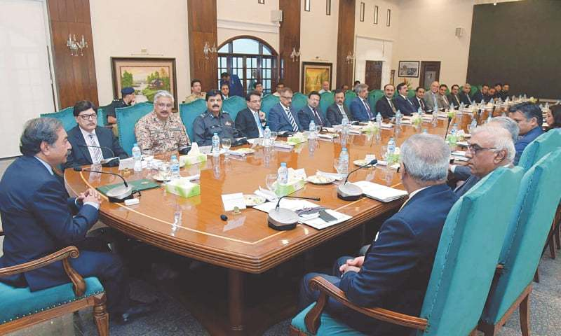 CARETAKER Chief Minister Fazal-ur-Rahman chairs a meeting regarding conduct of general elections at CM House on Monday.—PPI
