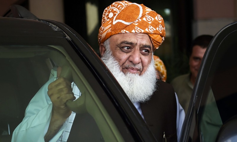 MMA chief Fazalur Rehman leaves after attending a meeting in Islamabad. —AFP