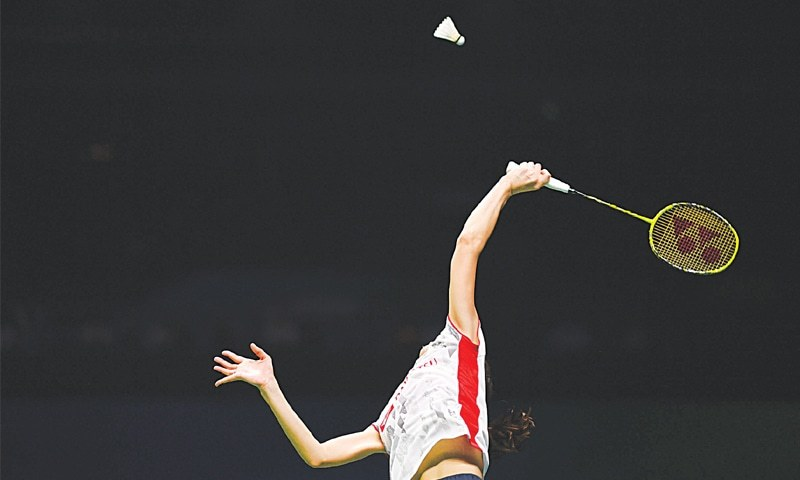 NANJING: Aya Ohori of Japan plays a shot against Malaysia's Goh Jin Wei during their women's singles match at the World Badminton Championships on Wednesday.—AFP
