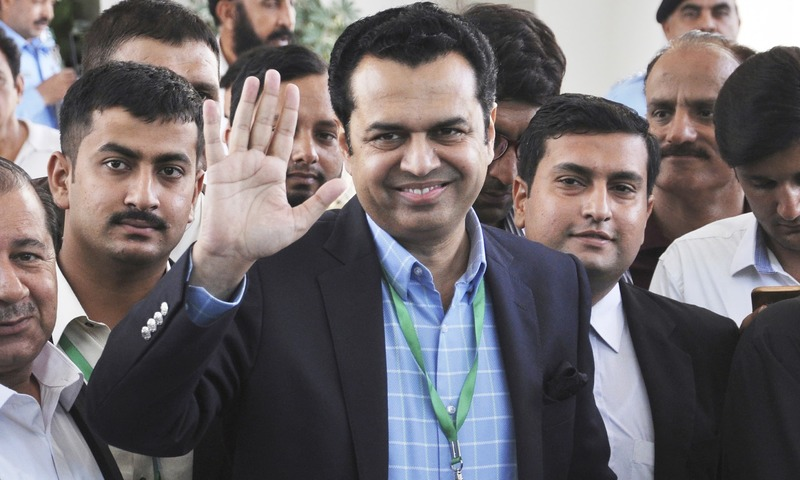 Former minister Talal Chaudhry waves as he leaves the SC building in Islamabad. —AP