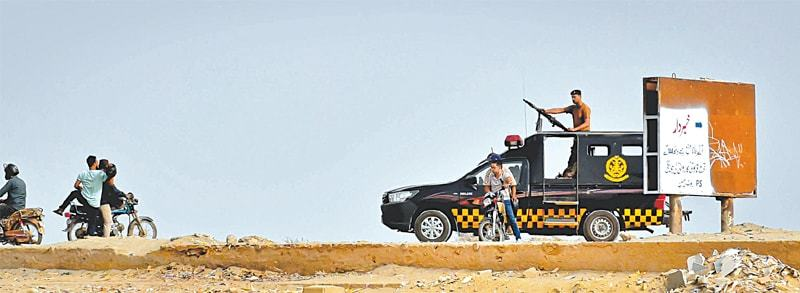 LAW enforcers warn motorcyclists to stay away from the breakwater pathway on Thursday.—Fahim Siddiqi/White Star