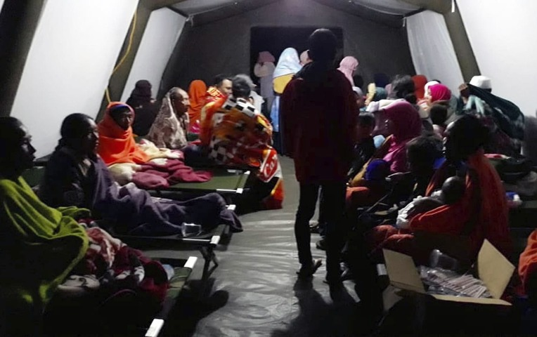 People affected by the earthquake rest at a temporary shelter in Lombok Indonesia Sunday Aug. 5 2018. —AP