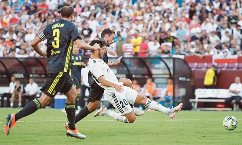 LANDOVER (Maryland): Real Madrid's Marco Asensio (C) taps in to score as Juventus' Giorgio Chiellini (L) looks on during the International Champions Cup at FedEx Field.—Reuters